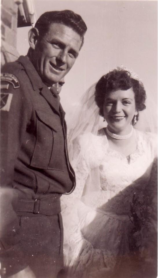 Image of man in army uniform and his bride circa 1955