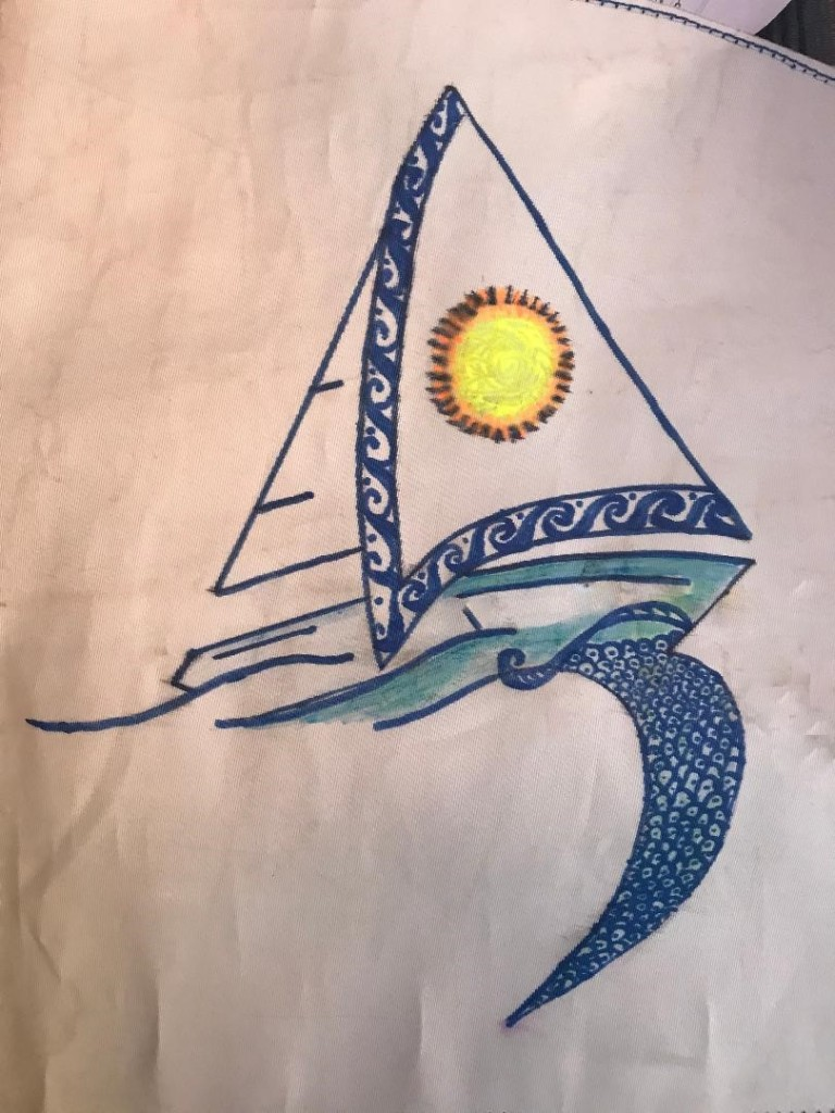 Image of drawn sailing boat as a burgee with Polynesian style trim on jib and a yellow sun and waves from the bow creating a stylised numeral 3
